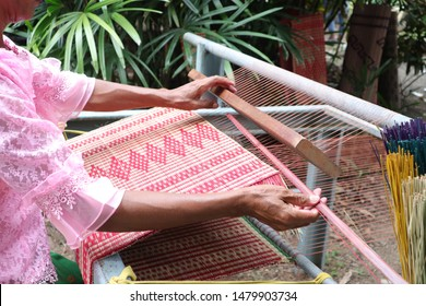 Weaving mats made from plants. It is an old way of life for the ancient Thai people.
