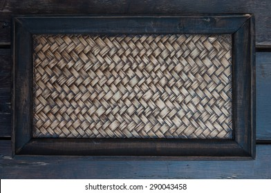 weaving tray on wooden background