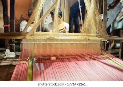 The weaving workshop and the loom there. The weavers are weaving Banarasi sari in Varanasi- Utter Pradesh India- April 2019
