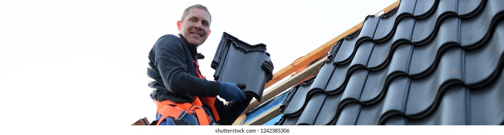 web background for roofer worker isolated, man on the roof with completed vocational training on free roof