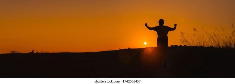 web banner adventure travel and wanderlust from silhouette man hiking and stand on top of the mountain in summer season