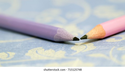 Web banner of colorful lead pencils on blue background