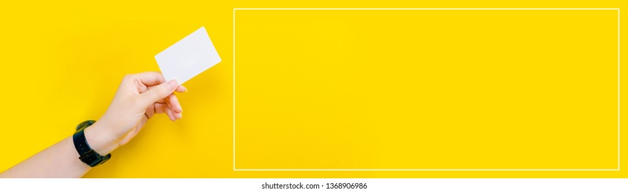 web banner design for business manner and activity concept with beauty woman hand hold name card or credit card in left hand with yellow pastel background