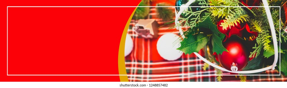 web banner design for christmas and new year event concept with gold and red shiny ball and other decorate item set on christmas tree with soft focus background