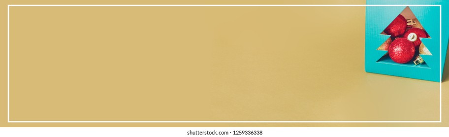web banner design for elegant holiday party event and celebration concept for shimmer and shine gold and red ball decorate on gold glitter background