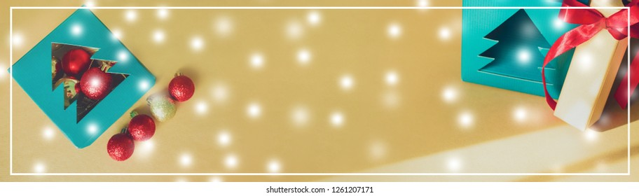 web banner design for elegant holiday party event and celebration concept for snow with  shimmer and shine gold and red ball decorate on gold glitter background