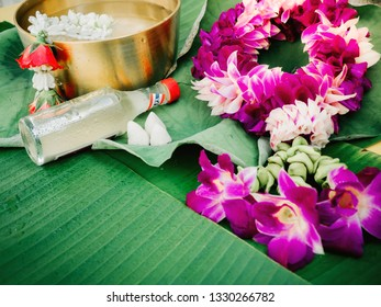 web banner design for spring and summer season festival concept from minimal flat lay tropical flower with orchid ,rose and lotus leaf decorate on banana leaf background for songkran ceremony