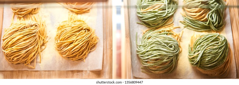 Web Banner of Fettuccine nests. Various mix of uncooked pasta in on wooden tray in the shop window. Different kind of dry macaroni in round form. Italian foods concept of spaghetti and menu design