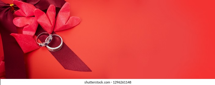 web banner love object in valentine's day concept from paper heart and wedding ring decorate in red background