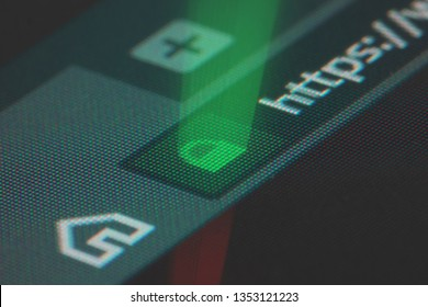 Web browser closeup on LCD screen with shallow focus with light shining through https padlock. Internet security, SSL certificate, cybersecurity, search engine and web browser concepts