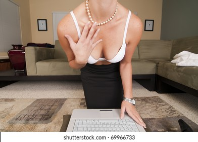 Web Cam Striptease #12.  Blonde in Business Attire Undressing as Viewed through a Web Cam.