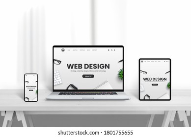 Web design company web site promotion od different devices. White wooden desk with clean background