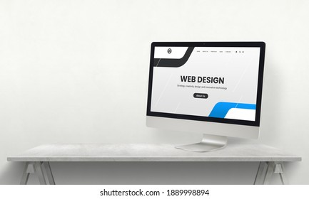 Web design studio desk with computer display and promo web page on it. Development team promotion concept