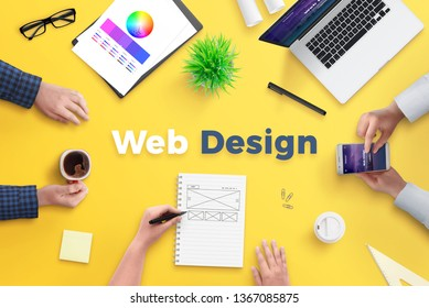 Web design team work on project concept. Yellow desk with web design text. Top view, flat lay. - Shutterstock ID 1367085875