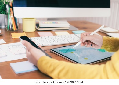 Web designer, UX UI designer designing mobile application user interface. Creative planning application development sketch layout wireframe design. User interface and User experience technology con