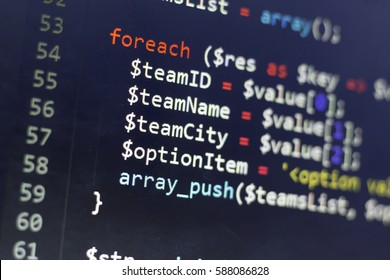 Web developer PHP code close up. Collection items traversing code. Abstract information technology modern background. Concept screen of experienced web developer.