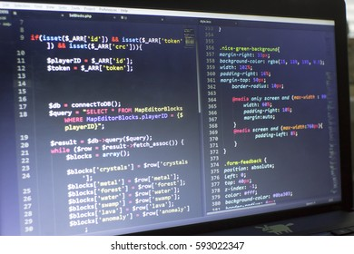 Web developer PHP and CSS3/LESS/SASS code close up. Database connecting code. Abstract information technology modern background. Concept screen of experienced web developer.