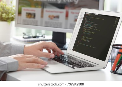Web developer is working on new website. web developer designer web code programmer computer application programming concept