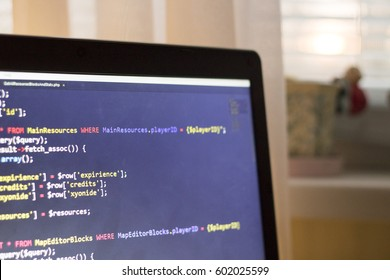 Web development PHP code close up. Abstract information digital technology modern background. Running SQL database queries. Screen corner of web developer.