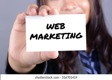 WEB MARKETING message on the card shown by businesswoman