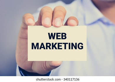 WEB MARKETING message on the card shown by a man, vintage tone