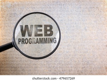 Web Programming. Magnifying optical glass on old paper background