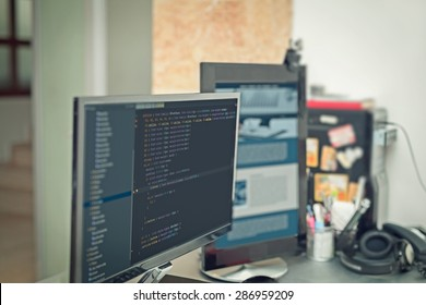 web site codes on computer monitor ar office