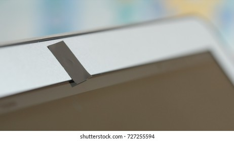 Webcam of laptop blocked by an adhesive tape