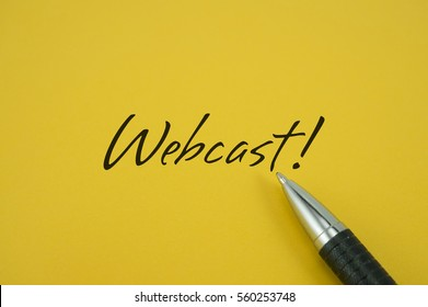 Webcast! note with pen on yellow background
