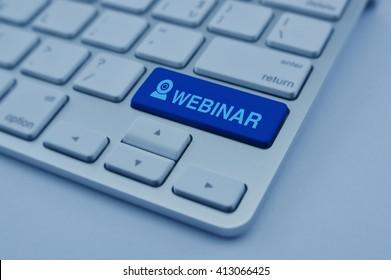 Webinar icon on modern computer keyboard button, Seminar online concept, blue tone