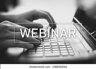 Webinar online, internet education, e-learning concept. Man typing on laptop keyboard.