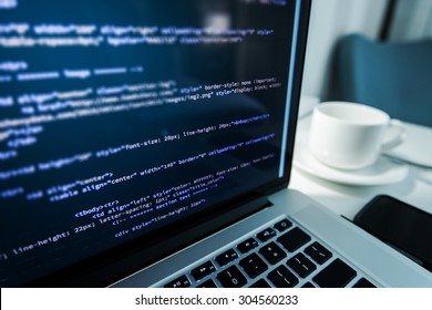 Website Coding. Website HTML Code on the Laptop Display Closeup Photo. Webdesigner Workstation.