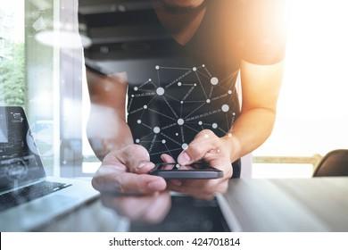 Website designer working digital tablet and smart phone and digital design diagram on wooden desk as concept
