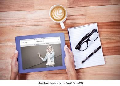 website frontpage against overhead of feminine hands using tablet