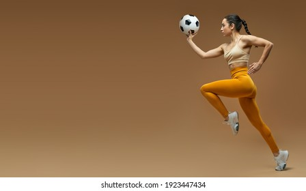 Website header of Athletic young woman with soccer ball running in studio