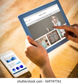 website homepage against over shoulder view of casual man using tablet