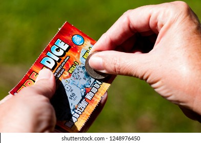 Webster County, West Virginia, USA, scratching a scratch-off lottery ticket, September 14, 2012