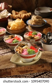 Wedang Angsle. Traditional Javanese warm dessert of sago pearls, rice noodles, agar agar, palm fruit, mung beans, peanuts in ginger and coconut milk soup. Served with other local traditional snack.