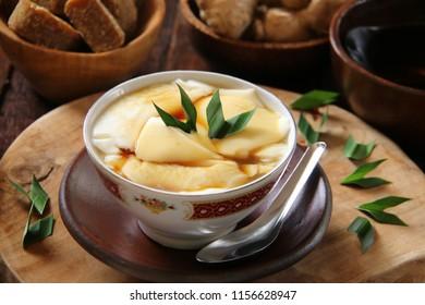 Wedang Tahu or Kembang Tahu.  Peranakan Dessert of Soybean Pudding in Ginger and Palm Sugar Syrup.