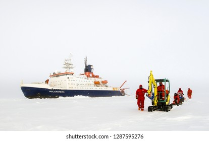 Weddell Sea, Antarctica – September 18, 2013: A scientist from the research icebreaker Polarstern are travelling with vessels need to setup an ice camp over an ice floe.
