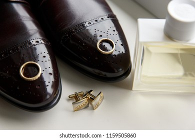 Wedding accessories for groom, shoes, wedding rings, perfume, cufflinks.