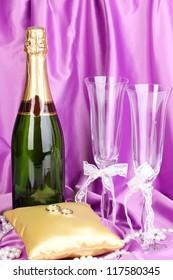 Wedding accessories on purple cloth background