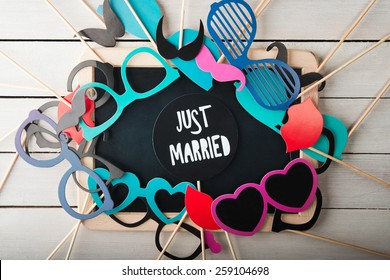 Wedding accessories set on wooden background