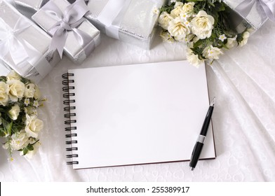 Wedding album, blank page, guest list, to do list