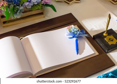 Wedding album, blank page, guest list, to do list.still life photography concept by memory and notebook.Notepad book.Notebook and asters on canvas background.soft and blur style for background.