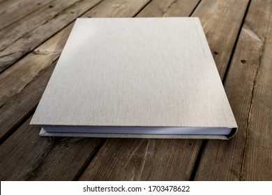 Wedding albums on beautiful wood background. Cloth cover without names. Can be used as design element. Set of albums. wedding, albums, books,