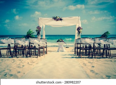 Wedding altar on the beach in Mexico with caribbean sea in the background