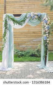 wedding arch. Arch for the wedding ceremony, decorated cloth flowers, greenery. wedding ceremony decorated with flowers in blue, white and green colors