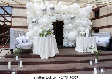 Wedding arch and chairs, photo zone of white balls