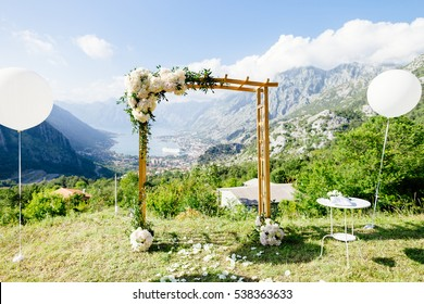 wedding arch with wedding decoration and sea view. Picturesque wedding location with balloons in fine art style